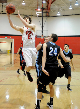 "Fairview High School's Gabe Tierney takes a shot over Mountain Range's Landon Staab, No. 24, on Friday, Jan. 6, during a basketball game at Fairview High School. Fairview won the game 65-41. For more photos of the game go to  <a href=""http://www.dailycamera.com"">http://www.dailycamera.com</a><br /> Jeremy Papasso/ Camera"