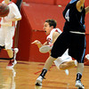 "Fairview High School's Holden Killeen dives to steal a pass from Mountain Range's Trent Hoffman on Friday, Jan. 6, during a basketball game at Fairview High School. Fairview won the game 65-41. For more photos of the game go to  <a href=""http://www.dailycamera.com"">http://www.dailycamera.com</a><br /> Jeremy Papasso/ Camera"