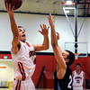 "Fairview High School's Holden Killeen goes for a shot over Mountain Range's Landon Staab on Friday, Jan. 6, during a basketball game at Fairview High School. Fairview won the game 65-41. For more photos of the game go to  <a href=""http://www.dailycamera.com"">http://www.dailycamera.com</a><br /> Jeremy Papasso/ Camera"