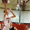 "Fairview High School's Brent Wrapp goes for a lay-up in front of  Mountain Range's Jacob Taylor on Friday, Jan. 6, during a basketball game at Fairview High School. Fairview won the game 65-41. For more photos of the game go to  <a href=""http://www.dailycamera.com"">http://www.dailycamera.com</a><br /> Jeremy Papasso/ Camera"
