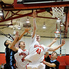 "Fairview High School's Alec Pronk goes for a lay-up over Mountain Range's Jaden Beach, right, on Friday, Jan. 6, during a basketball game at Fairview High School. Fairview won the game 65-41. For more photos of the game go to  <a href=""http://www.dailycamera.com"">http://www.dailycamera.com</a><br /> Jeremy Papasso/ Camera"