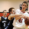 "Fairview High School's Alec Pronk, right, fights to keep control of the ball with Mountain Range's Logan Tanner on Friday, Jan. 6, during a basketball game at Fairview High School. Fairview won the game 65-41. For more photos of the game go to  <a href=""http://www.dailycamera.com"">http://www.dailycamera.com</a><br /> Jeremy Papasso/ Camera"