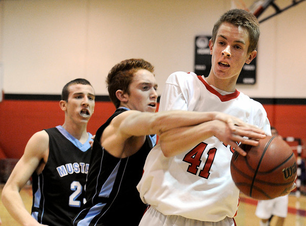 """Fairview High School's Alec Pronk, right, fights to keep control of the ball with Mountain Range's Logan Tanner on Friday, Jan. 6, during a basketball game at Fairview High School. Fairview won the game 65-41. For more photos of the game go to  <a href=""""http://www.dailycamera.com"""">http://www.dailycamera.com</a><br /> Jeremy Papasso/ Camera"""