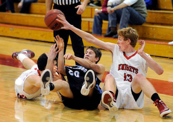 "Fairview High School's Joe Thompson, left, Mountain Range's Tanner Waufle and Fairview's Jay Arehart fight for a loose ball on Friday, Jan. 6, during a basketball game at Fairview High School. Fairview won the game 65-41. For more photos of the game go to  <a href=""http://www.dailycamera.com"">http://www.dailycamera.com</a><br /> Jeremy Papasso/ Camera"