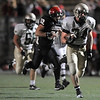 "Mountain Vista senior Jesse Geary rushes in for a touchdown while being chased by Fairview sophomore Cito Balsells during the football game on Thursday, Sept. 16, at Recht Field in Boulder. Fairview lost 34-14.<br /> For photo gallery go to  <a href=""http://www.dailycamera.com"">http://www.dailycamera.com</a><br /> Jeremy Papasso/ Camera"