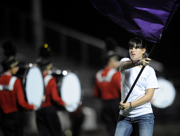 "Fairview junior Nikki Sandberg performs with the school color guard during halftime of the football game on Thursday, Sept. 16, at Recht Field in Boulder. Fairview lost 34-14.<br /> For photo gallery go to  <a href=""http://www.dailycamera.com"">http://www.dailycamera.com</a><br /> Jeremy Papasso/ Camera"