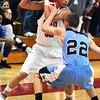 FVHS03<br /> Fairview's Michael Melillo is pressured by Edgar Crockett of Mountain Range.<br /> Photo by Marty Caivano/Camera/March 2, 2010