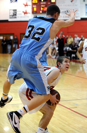FVHS06<br /> Fairview's Craig Saltarelli waits for an opening to shoot while being guarded by Mitch Castillo of Mountain Range.<br /> Photo by Marty Caivano/Camera/March 2, 2010