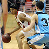FVHS05<br /> Fairview's Kenny Bell evades Mitch Castillo of Mountain Range.<br /> Photo by Marty Caivano/Camera/March 2, 2010