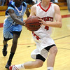 FVHS02<br /> Fairview's Will Oldham drives past Taylor Maunu of Mountain Range.<br /> Photo by Marty Caivano/Camera/March 2, 2010