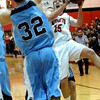 FVHS04<br /> Fairview's Shane O'Neill goes up for a shot despite being crowded by Mountain Range players, including Mitch Castillo, foreground.<br /> Photo by Marty Caivano/Camera/March 2, 2010