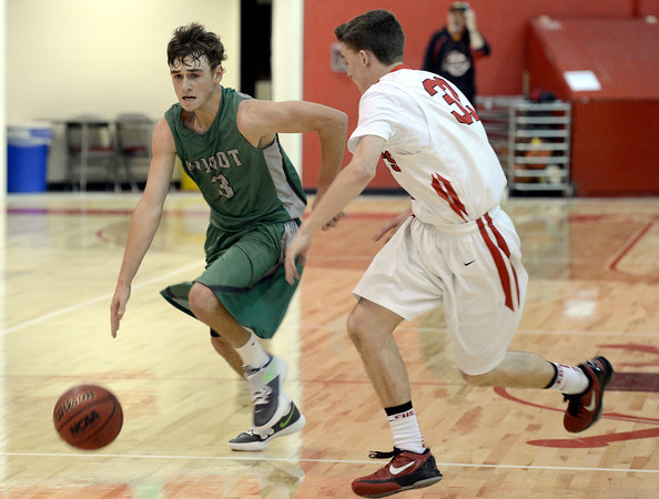 """Niwot High School's Jordan Keeler dribbles past Matt Twist during a game against Fairview High School on Monday, Dec. 10, at Fairview High School in Boulder. For more photos of the game go to  <a href=""""http://www.dailycamera.com"""">http://www.dailycamera.com</a><br /> Jeremy Papasso/ Camera"""