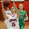 "Fairview High School's Luke Schneider goes for a layup in front of Madison Bounds during a game against Niwot High School on Monday, Dec. 10, at Fairview High School in Boulder. For more photos of the game go to  <a href=""http://www.dailycamera.com"">http://www.dailycamera.com</a><br /> Jeremy Papasso/ Camera"