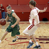 "Niwot High School's Kyle Kowakowski drives past Brent Wrapp during a game against Fairview High School on Monday, Dec. 10, at Fairview High School in Boulder. For more photos of the game go to  <a href=""http://www.dailycamera.com"">http://www.dailycamera.com</a><br /> Jeremy Papasso/ Camera"