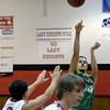 "Niwot High School's Forrest Lee takes a shot over Cubby Lane during a game against Fairview High School on Monday, Dec. 10, at Fairview High School in Boulder. For more photos of the game go to  <a href=""http://www.dailycamera.com"">http://www.dailycamera.com</a><br /> Jeremy Papasso/ Camera"