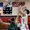 "Fairview High School's Gabe Tierney takes a shot over Nate Merriman during a game against Niwot High School on Monday, Dec. 10, at Fairview High School in Boulder. For more photos of the game go to  <a href=""http://www.dailycamera.com"">http://www.dailycamera.com</a><br /> Jeremy Papasso/ Camera"