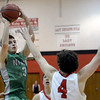 "Niwot High School's Jordan Keeler takes a shot over Gabe Tierney during a game against Fairview High School on Monday, Dec. 10, at Fairview High School in Boulder. For more photos of the game go to  <a href=""http://www.dailycamera.com"">http://www.dailycamera.com</a><br /> Jeremy Papasso/ Camera"
