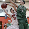 "Fairview High School's Trevor McQuenney takes a shot under the guard of Clarke Colwell during a game against Niwot High School on Monday, Dec. 10, at Fairview High School in Boulder. For more photos of the game go to  <a href=""http://www.dailycamera.com"">http://www.dailycamera.com</a><br /> Jeremy Papasso/ Camera"