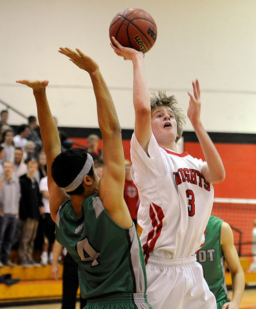 "Fairview High School's Brent Wrapp takes a shot over Forrest Lee during a game against Niwot High School on Monday, Dec. 10, at Fairview High School in Boulder. For more photos of the game go to  <a href=""http://www.dailycamera.com"">http://www.dailycamera.com</a><br /> Jeremy Papasso/ Camera"