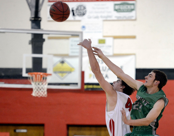 """Fairview High School's Gabe Tierney, left, wins the tip off against Clarke Colwell during a game against Niwot High School on Monday, Dec. 10, at Fairview High School in Boulder. For more photos of the game go to  <a href=""""http://www.dailycamera.com"""">http://www.dailycamera.com</a><br /> Jeremy Papasso/ Camera"""