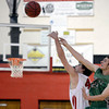 "Fairview High School's Gabe Tierney, left, wins the tip off against Clarke Colwell during a game against Niwot High School on Monday, Dec. 10, at Fairview High School in Boulder. For more photos of the game go to  <a href=""http://www.dailycamera.com"">http://www.dailycamera.com</a><br /> Jeremy Papasso/ Camera"