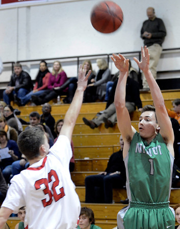 "Niwot High School's Austin Hart takes a shot over Matt Twist during a game against Fairview High School on Monday, Dec. 10, at Fairview High School in Boulder. For more photos of the game go to  <a href=""http://www.dailycamera.com"">http://www.dailycamera.com</a><br /> Jeremy Papasso/ Camera"