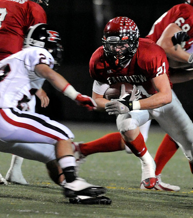 Fairview High School senior Brian Sture tries to run the ball past Pomona junior Zach Perez on Friday, Oct. 15, during a football game against Pomona at Recht Field in Boulder. <br /> Jeremy Papasso/ Camera