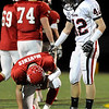 Pomona junior Keegan Pratt, right, tries to console Fairview quarterback Michael McVenes after he fumbled the ball in the second quarter of the football game on Friday, Oct. 15, at Recht Field in Boulder. Pomona recovered the fumble.<br /> Jeremy Papasso/ Camera