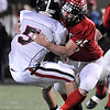 Fairview junior Max Newey tackles Pomona junior Dylan Carter for a loss of yards on Friday, Oct. 15, during a football game against Pomona at Recht Field in Boulder. <br /> Jeremy Papasso/ Camera