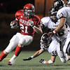 Fairview High School senior Brian Sture rushes the ball on Friday, Oct. 15, during a football game against Pomona at Recht Field in Boulder. <br /> Jeremy Papasso/ Camera