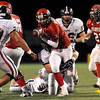 Fairview quarterback Michael McVenves fumbles the ball in the second quarter of the football game on Friday, Oct. 15, during a football game against Pomona at Recht Field in Boulder. <br /> Jeremy Papasso/ Camera