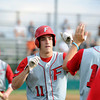 "Fairview's Will Stoorman, middle, and Jeremy Katz, left, are high-fived by teammates after scoring during a baseball game against Pomona High School on Thursday, June 14, at Pomona High School in Arvada. For more photos of the game go to  <a href=""http://www.dailycamera.com"">http://www.dailycamera.com</a><br /> Jeremy Papasso/ Boulder Daily Camera"