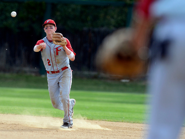 "Fairview's Jeremy Katz makes an out at first base during a baseball game against Pomona High School on Thursday, June 14, at Pomona High School in Arvada. For more photos of the game go to  <a href=""http://www.dailycamera.com"">http://www.dailycamera.com</a><br /> Jeremy Papasso/ Boulder Daily Camera"