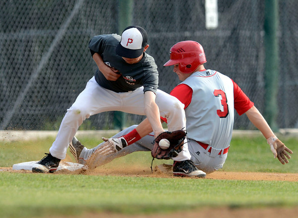 "Fairview's Cameron Frazier slides into third base safely under the tag of Pomona's Danny Thistle during a baseball game on Thursday, June 14, at Pomona High School in Arvada. For more photos of the game go to  <a href=""http://www.dailycamera.com"">http://www.dailycamera.com</a><br /> Jeremy Papasso/ Boulder Daily Camera"