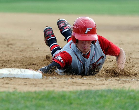 """Fairview's Walker Harris slides back to first base safely after being checked by Pomona pitcher Ryan Abts during a baseball game against Pomona High School on Thursday, June 14, at Pomona High School in Arvada. For more photos of the game go to  <a href=""""http://www.dailycamera.com"""">http://www.dailycamera.com</a><br /> Jeremy Papasso/ Boulder Daily Camera"""