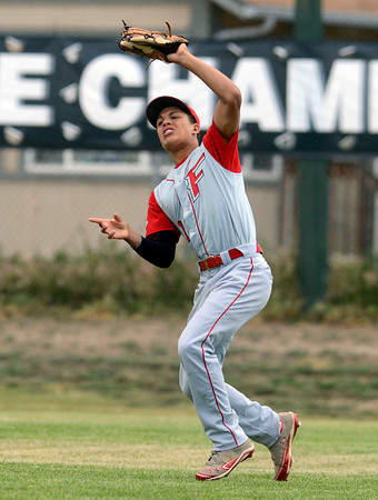 "Fairview's Tim Ryan makes a catch in the outfield during a baseball game against Pomona High School on Thursday, June 14, at Pomona High School in Arvada. For more photos of the game go to  <a href=""http://www.dailycamera.com"">http://www.dailycamera.com</a><br /> Jeremy Papasso/ Boulder Daily Camera"