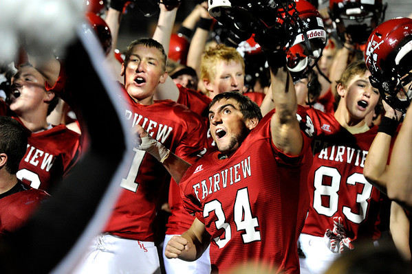 "Fairview High School's Andrew Bedell, No. 34, chants the fight song with his teammates on Friday, Sept. 2, after defeating Poudre High School at Recht Field in Boulder. Fairview won 21-3. For more photos of the game go to  <a href=""http://www.dailycamera.com"">http://www.dailycamera.com</a><br /> Jeremy Papasso/ Camera"