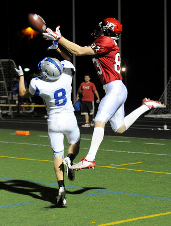 "Fairview High School's Sam Martin tries to catch a pass over Poudre's Spencer Long on Friday, Sept. 2, during a football game against Poudre High School at Recht Field in Boulder. Fairview won 21-3. For more photos of the game go to  <a href=""http://www.dailycamera.com"">http://www.dailycamera.com</a><br /> Jeremy Papasso/ Camera"