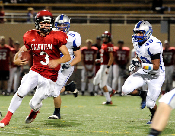 "Fairview High School's Michael McVenes runs the ball on Friday, Sept. 2, during a football game against Poudre High School at Recht Field in Boulder. Fairview won 21-3. For more photos of the game go to  <a href=""http://www.dailycamera.com"">http://www.dailycamera.com</a><br /> Jeremy Papasso/ Camera"