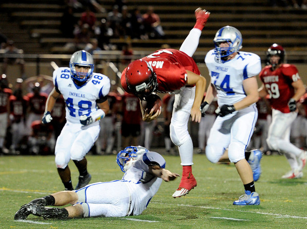 """Fairview High School's Michael McVenes flies through the air after being hit by Poudre High School's Kade Koster, bottom, on Friday, Sept. 2, during a football game against Poudre High School at Recht Field in Boulder. Fairview won 21-3. For more photos of the game go to  <a href=""""http://www.dailycamera.com"""">http://www.dailycamera.com</a><br /> Jeremy Papasso/ Camera"""