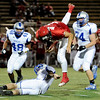 "Fairview High School's Michael McVenes flies through the air after being hit by Poudre High School's Kade Koster, bottom, on Friday, Sept. 2, during a football game against Poudre High School at Recht Field in Boulder. Fairview won 21-3. For more photos of the game go to  <a href=""http://www.dailycamera.com"">http://www.dailycamera.com</a><br /> Jeremy Papasso/ Camera"