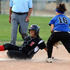 FAIRVIEW03<br /> Fairview's Haley Todacheene escapes the tag of Poudre's Kasey Cash at second base.<br /> Photo by Marty Caivano / The Camera / Sept. 29, 2009