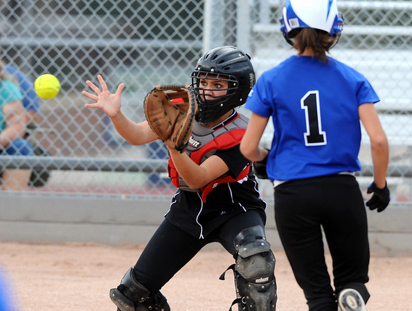 FAIRVIEW02<br /> Fairview's catcher, Melissa Schreiner, waits for the ball to tag out Darian Ramos of Poudre on Tuesday.<br /> Photo by Marty Caivano / The Camera / Sept. 29, 2009