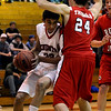 Fairview's Michael Melillo (left) is pressured by Bud Thomas (right)Regis' during their basketball game in the Fairview Festival in Boulder, Colorado December 11, 2009.  CAMERA/Mark Leffingwell