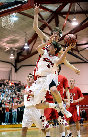 Fairview's Will Oldham (front) is fouled by Regis' Bud Thomas (back) during their basketball game in the Fairview Festival in Boulder, Colorado December 11, 2009.  CAMERA/Mark Leffingwell