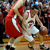 Fairview's Shane O'Neill (right) pushes forward while being guarded by Regis' Damian Mencini (left) during their basketball game in the Fairview Festival in Boulder, Colorado December 11, 2009.  CAMERA/Mark Leffingwell