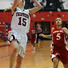 FVHS06<br /> Fairview's Kristen Narum shoots while Bianca Jones of Smoky Hill is too late to block.<br /> Photo by Marty Caivano/Camera/Feb. 24, 2010