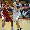 FVHS03<br /> Fairview's Maya Singer drives past Nichelle Dobbs of Smoky Hill.<br /> Photo by Marty Caivano/Camera/Feb. 24, 2010
