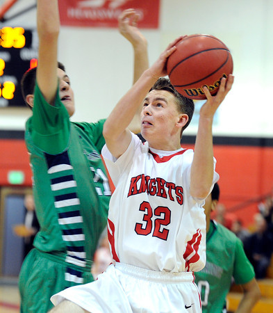 "Fairview High School's Matt Twist drives past Zach Pirog during a game against Thunder Ridge High School at Fairview in Boulder. For more photos of the game go to  <a href=""http://www.dailycamera.com"">http://www.dailycamera.com</a><br /> Jeremy Papasso/ Camera"