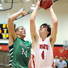 """Fairview High School's Gabe Tierney takes a shot over Zach Rusk during a game against Thunder Ridge High School at Fairview in Boulder. For more photos of the game go to  <a href=""""http://www.dailycamera.com"""">http://www.dailycamera.com</a><br /> Jeremy Papasso/ Camera"""